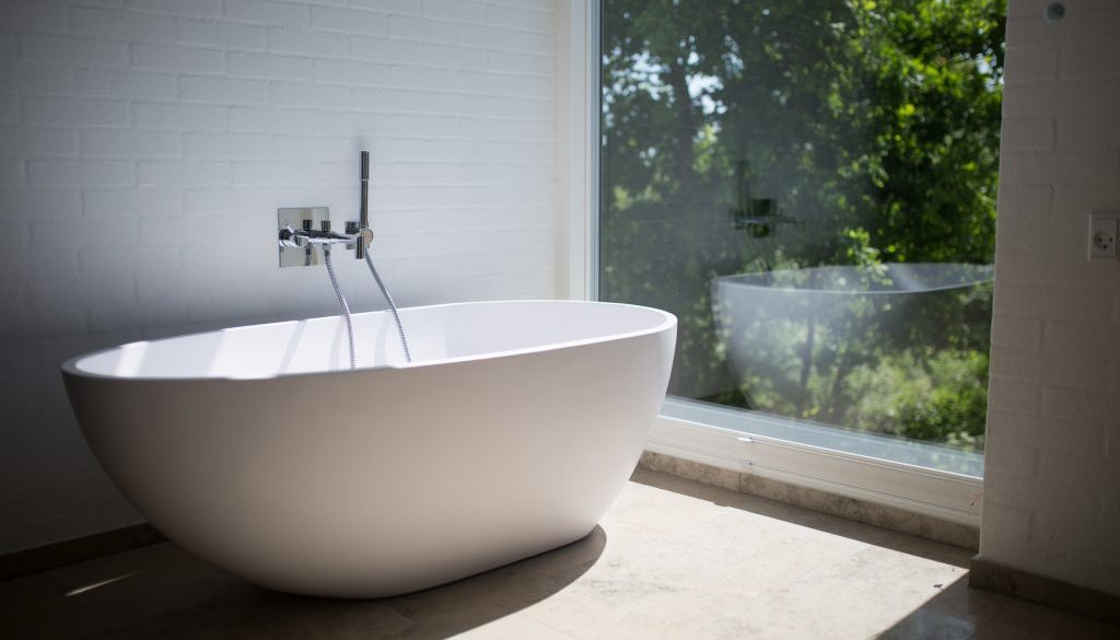 white-ceramic-bathtub-beside-clear-glass-wall-1358912