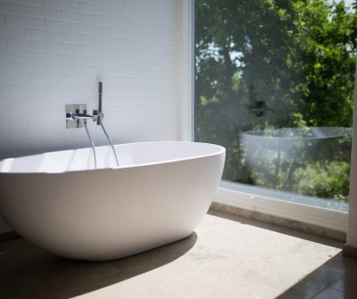 white-ceramic-bathtub-beside-clear-glass-wall-1358912